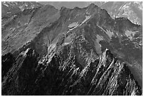 Steep forested spires in dabbled light, North Cascades National Park. Washington, USA. (black and white)