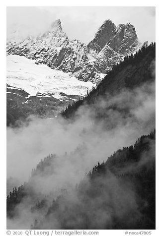 Inspiration Peak and the Pyramid rising above clouds, North Cascades National Park.  (black and white)