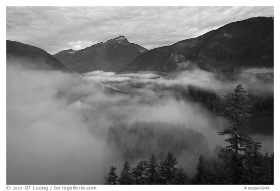 Low fog rolling over Diablo Lake, dawn, North Cascades National Park Service Complex.  (black and white)