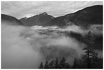 Low fog rolling over Diablo Lake, dawn, North Cascades National Park Service Complex.  ( black and white)