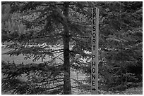 Sign pointing to phone used to call Ross Lake resort, North Cascades National Park Service Complex.  ( black and white)