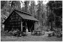 Hiker at high Bridge campground shelter, North Cascades National Park.  ( black and white)