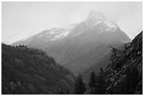 Snow-capped jagged peak in clouds, North Cascades National Park.  ( black and white)