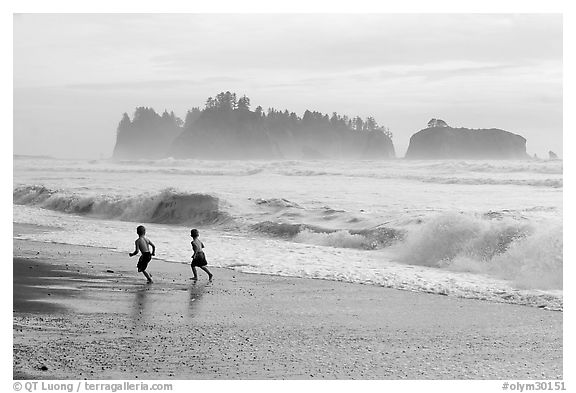 Children running along surf, Rialto Beach. Olympic National Park (black and white)