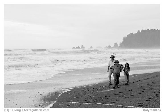 Black and white picture photo family walking on rialto beach olympic national park