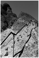 High Peaks trails with stairs carved in stone. Pinnacles National Park, California, USA. (black and white)