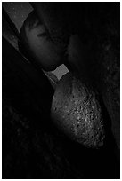 Talus cave with boulders at night. Pinnacles National Park, California, USA. (black and white)