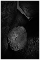 Boulder in Balconies talus cave at night. Pinnacles National Park, California, USA. (black and white)