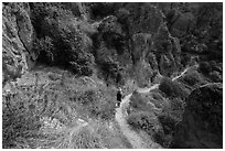 Hiker on trail in spring. Pinnacles National Park, California, USA. (black and white)