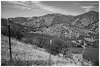 Boundary fence along steep hill. Pinnacles National Park, California, USA. (black and white)