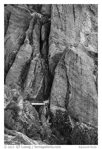 Footbridge at Tunnel exit dwarfed by rock towers. Pinnacles National Park (black and white)