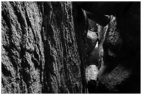 Narrow talus cave, Bear Gulch Cave. Pinnacles National Park ( black and white)