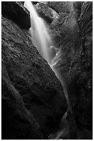 Waterfall spilling down from reservoir into Bear Gulch Cave. Pinnacles National Park ( black and white)