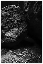 Running water, boulders, Bear Gulch cave. Pinnacles National Park ( black and white)