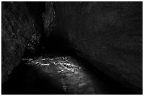 Light on stream in dark cave. Pinnacles National Park ( black and white)