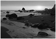 Stream and beach at sunset, False Klamath Cove. Redwood National Park, California, USA. (black and white)