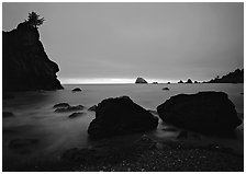 Rocks and seastacks, cloudy sunset. Redwood National Park, California, USA. (black and white)