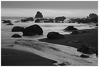 Stream, rocks, and ocean at dusk, False Klamath cove. Redwood National Park, California, USA. (black and white)