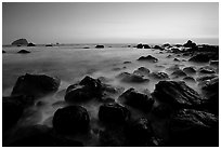 Boulders and ocean at dusk, False Klamath cove. Redwood National Park, California, USA. (black and white)