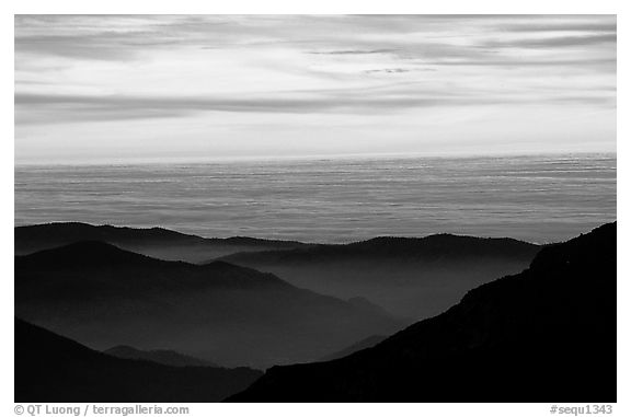 Receding lines of  foothills and sea of clouds at sunset. Sequoia National Park (black and white)