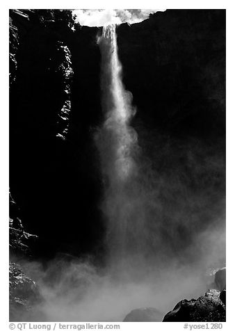 Bridalveil Falls as sun reaches upper shaft of water. Yosemite National Park (black and white)