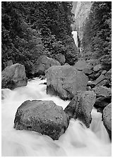 Boulders in frosty Merced River and distant Vernal Fall. Yosemite National Park ( black and white)