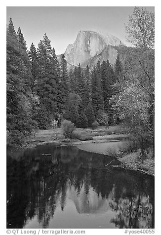 Half Dome reflected in Merced River at sunset. Yosemite National Park (black and white)