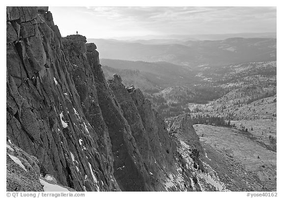 Cliffs on  North Face of Mount Hoffman with hiker standing on top. Yosemite National Park (black and white)