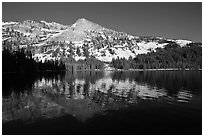 Tenaya Lake, with partly snow-covered peak reflected. Yosemite National Park ( black and white)