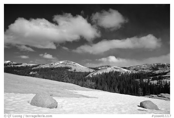 Snow on slab, boulders, and distant domes, Tuolumne Meadows. Yosemite National Park (black and white)