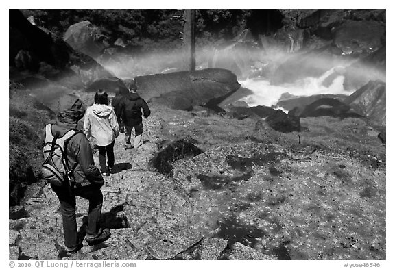 Hikers walking through rainbow, Mist Trail. Yosemite National Park (black and white)