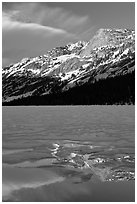 Peak reflected in thawing Tenaya Lake. Yosemite National Park ( black and white)