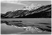 Tenaya Peak reflected in partly iced Tenaya Lake. Yosemite National Park ( black and white)