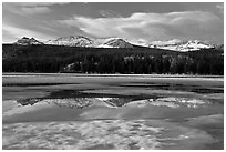 Peaks reflected in snow melt pool, Twolumne Meadows, sunset. Yosemite National Park ( black and white)