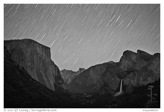 Yosemite Valley by night with star trails. Yosemite National Park (black and white)