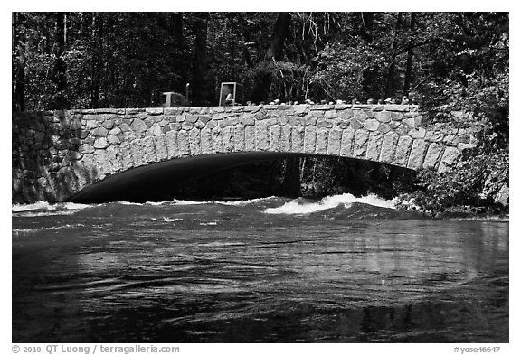 Pohono Bridge with high waters. Yosemite National Park (black and white)