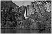 High waters of the Merced River under the Swinging Bridge. Yosemite National Park, California, USA. (black and white)