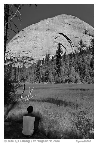 Hiker sitting at Lost Lake on west side Half-Dome. Yosemite National Park (black and white)