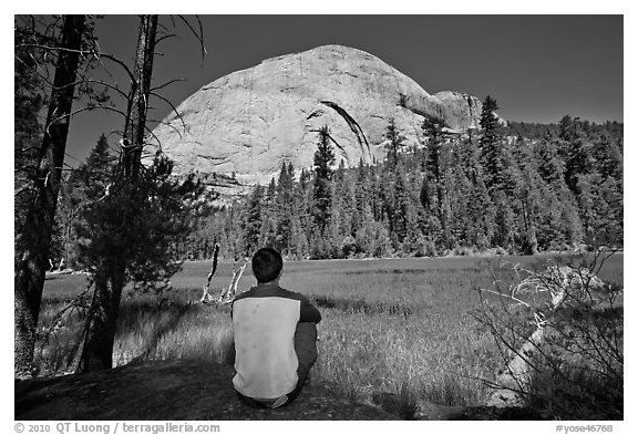 Hiker looking at backside of Half-Dome from Lost Lake. Yosemite National Park (black and white)