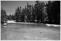 Merced River flowing over smooth granite. Yosemite National Park ( black and white)