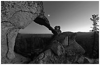 Indian Arch and moon at dusk. Yosemite National Park, California, USA. (black and white)