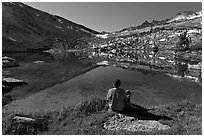 Hiker sitting by alpine lake, Vogelsang. Yosemite National Park ( black and white)