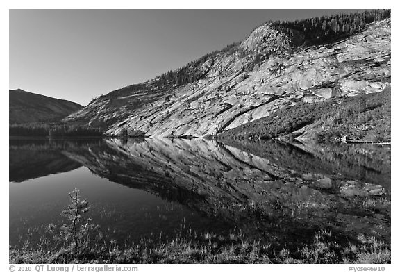 Peaks reflected in mirror-like waters, Merced Lake. Yosemite National Park (black and white)