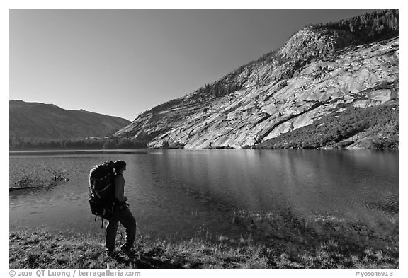 Park visitor with backpack looking, Merced Lake, morning. Yosemite National Park (black and white)