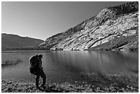 Park visitor with backpack looking, Merced Lake, morning. Yosemite National Park, California, USA. (black and white)