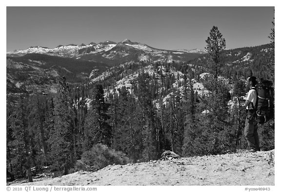 Backpacker surveying high country from Cathedral Pass. Yosemite National Park (black and white)