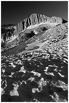 Neve with sun cups on the Sierra Crest, and North Peak. Yosemite National Park, California, USA. (black and white)