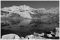Rugged mountain reflected in Sierra Lake. Yosemite National Park ( black and white)