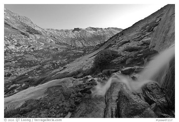 Waterfall and alpine valley at sunset. Yosemite National Park (black and white)