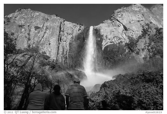 Tourists looking at Bridalvail Fall rainbow. Yosemite National Park (black and white)